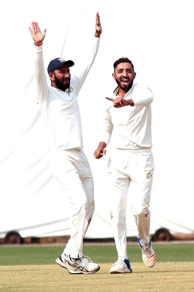 Saurashtra's Jaydev Unadkat celebrates fall a wicket during the Ranji Trophy second semi-final match between Karnataka and Saurashtra at M. Chinnaswamy Stadium in Bengaluru on Jan 26, 2019.