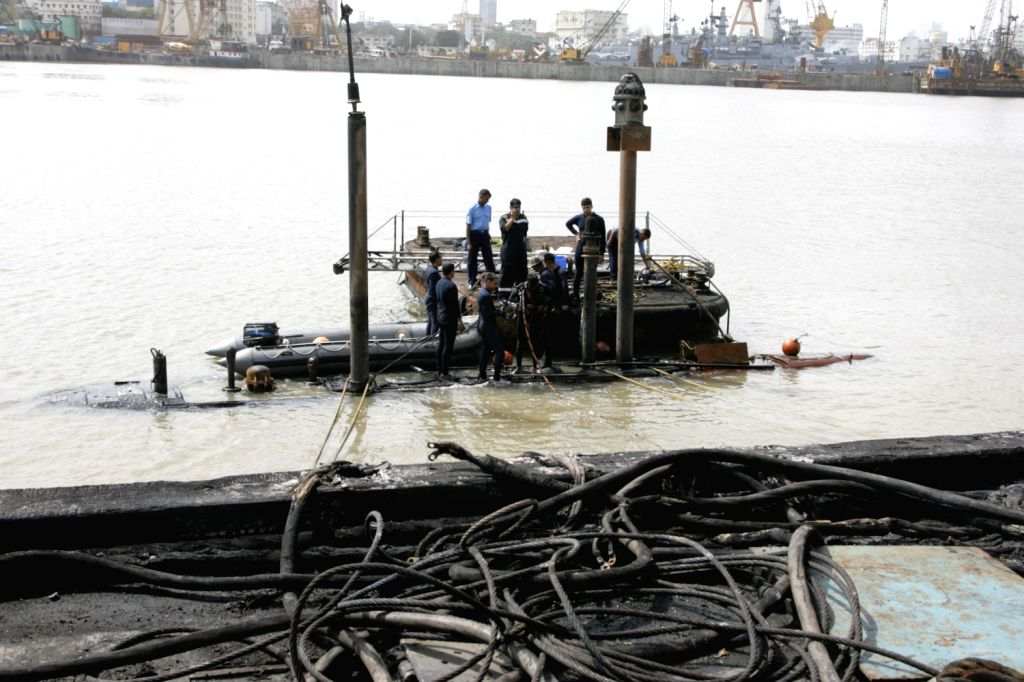Scene of the site at the Naval Dockyard in Mumbai on Wednesday where the INS Sindhurakshak sank after an explosion early in the morning. (Photo::: IANS)