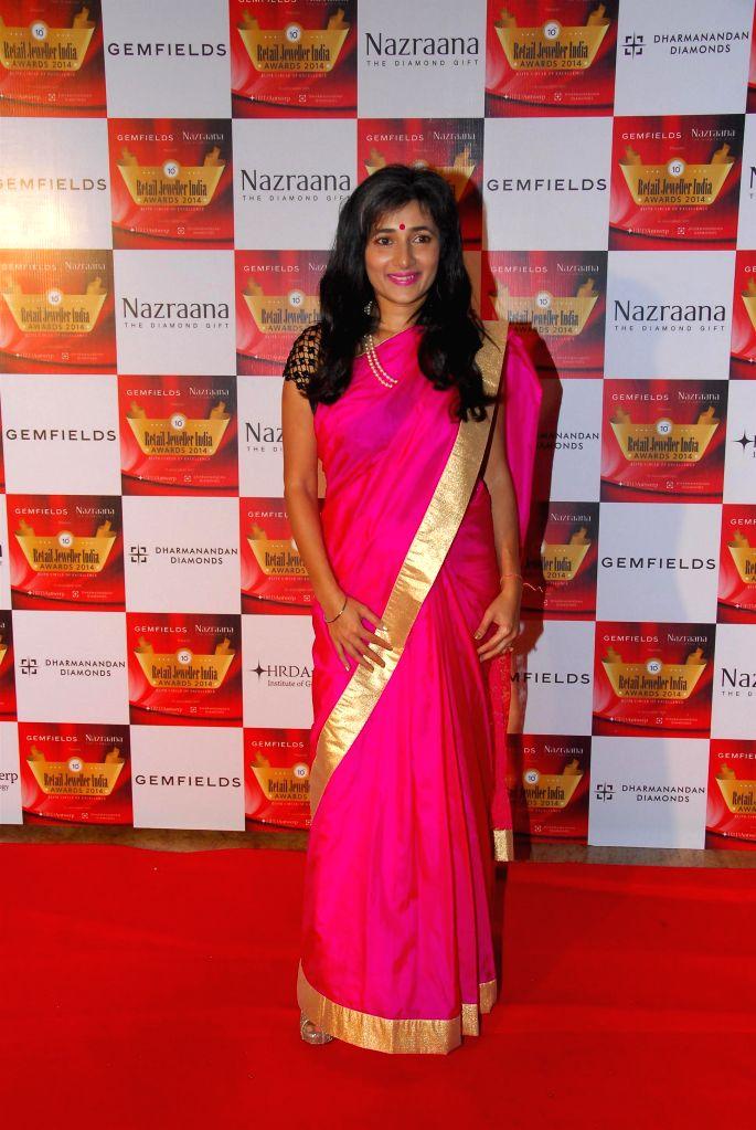 Schauna Chauhan Saluja, CEO, Parle Agro Pvt. Ltd. during during the 10th Annual Gemfields and Nazraana Retail Jeweller India Awards 2014 in Mumbai on July 19, 2014. (Photo : IANS) - Schauna Chauhan Saluja