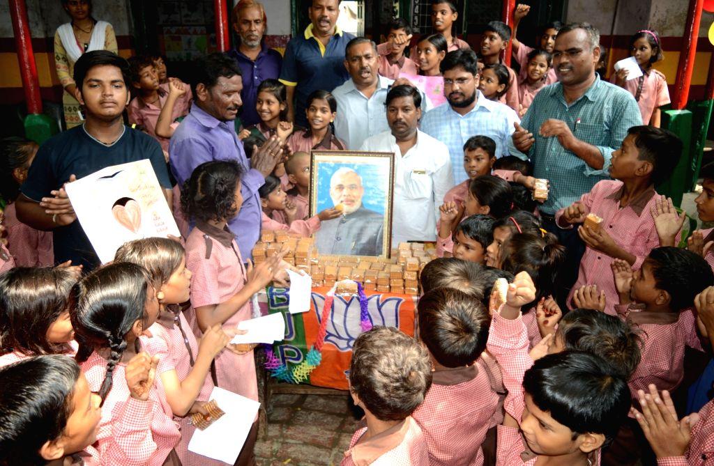 School children celebrate on the eve of Prime Minister Narendra Modi's birthday in Varansi on Sept 16, 2017. - Narendra Modi