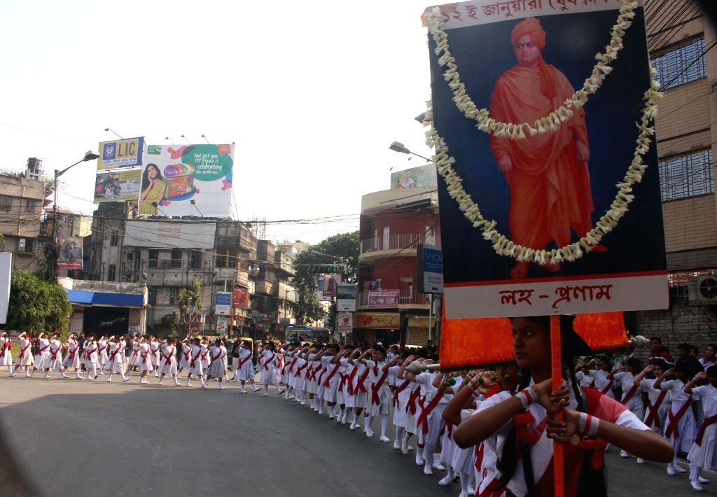 School children participate in a rally on the occasion of Swami Vivekananda's birth anniversary in Kolkata on Jan 12, 2020.