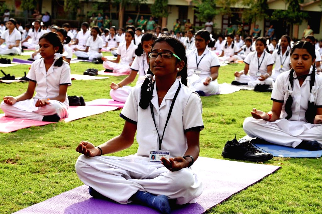 School children performs yoga on International Yoga Day in Chennai on June 21, 2017.