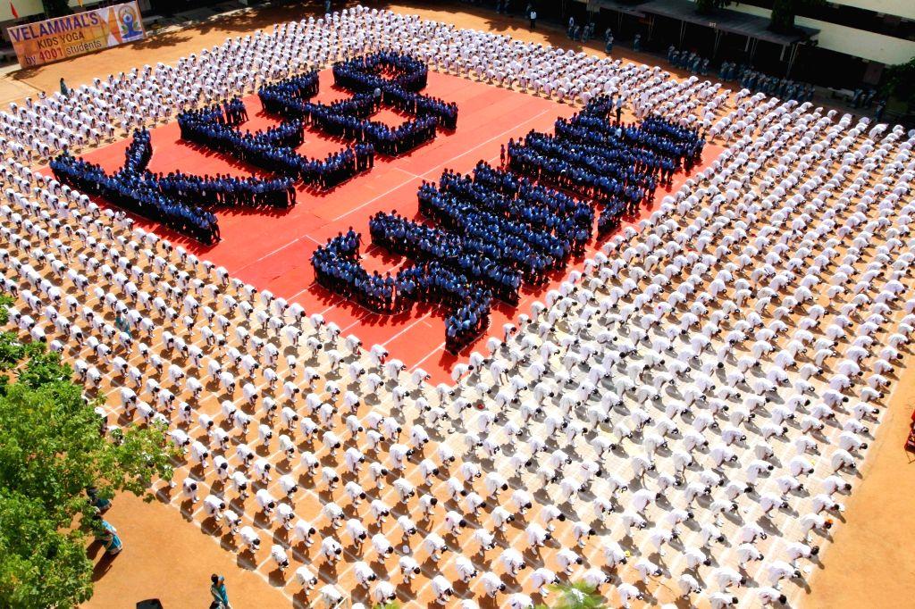 School children practice yoga ahead of International Day of Yoga in Chennai on June 20, 2016.