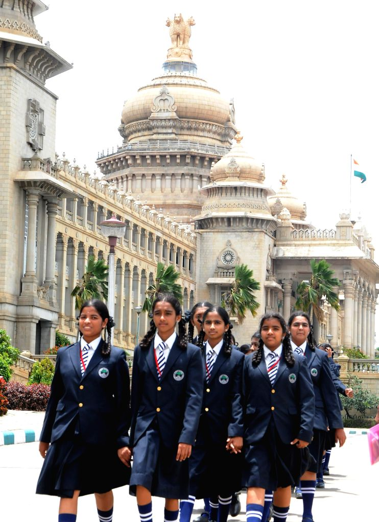 School students arriving to watch monsoon assembly session at Vidhana Soudha in Bangalore on July 24, 2014.