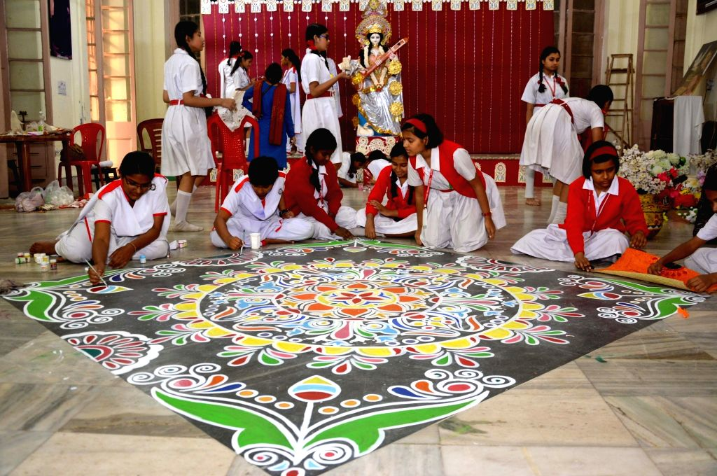 School students busy with Saraswati Puja preparations in Kolkata on Feb 8, 2019.