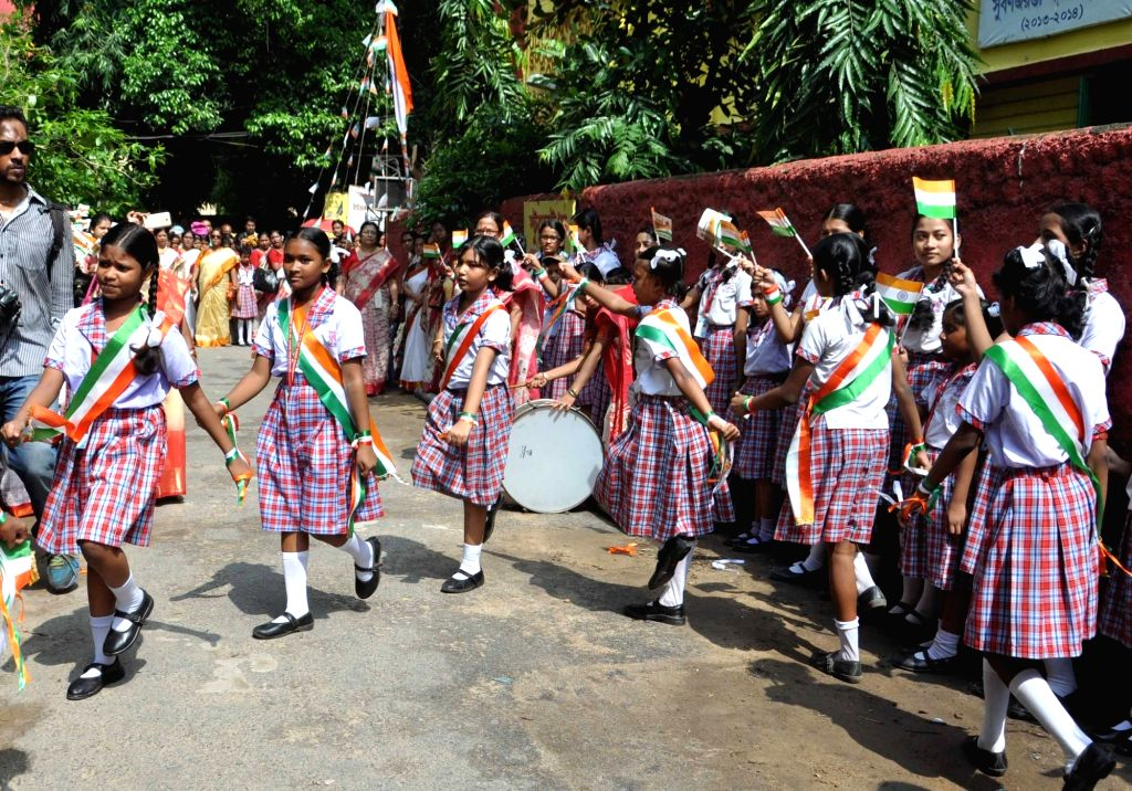School students celebrate Independence Day in Kolkata, on Aug 15, 2016.