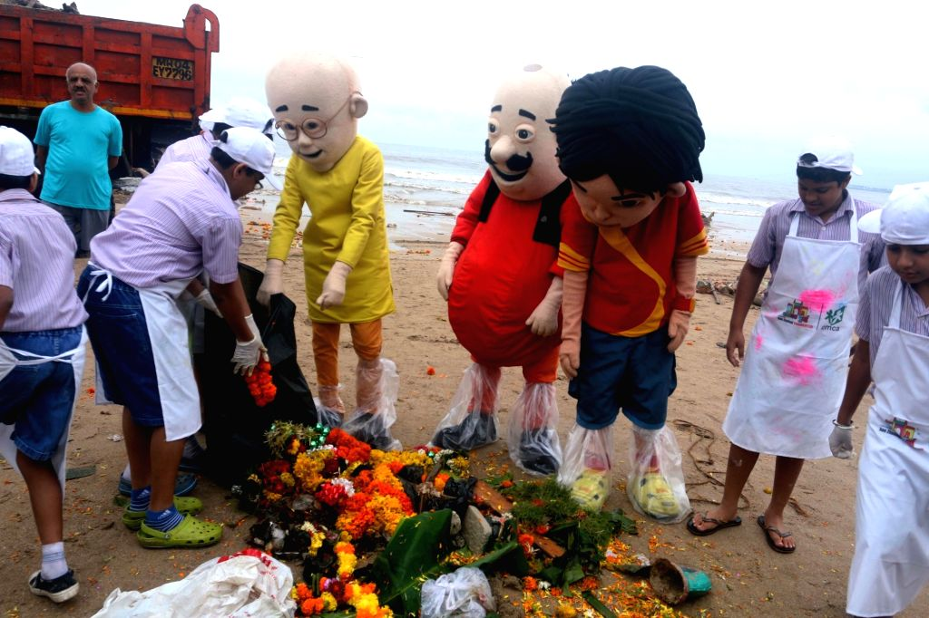 School students clean-up Juhu beach a day after Ganesha immersions in Mumbai, on Sept 16, 2016.