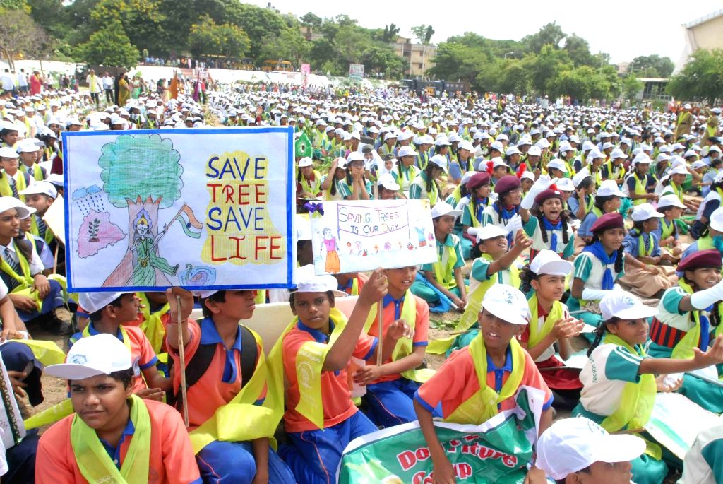 School students during during tree plantation drive Yousufguda police line in Hyderabad on Aug 5, 2017.