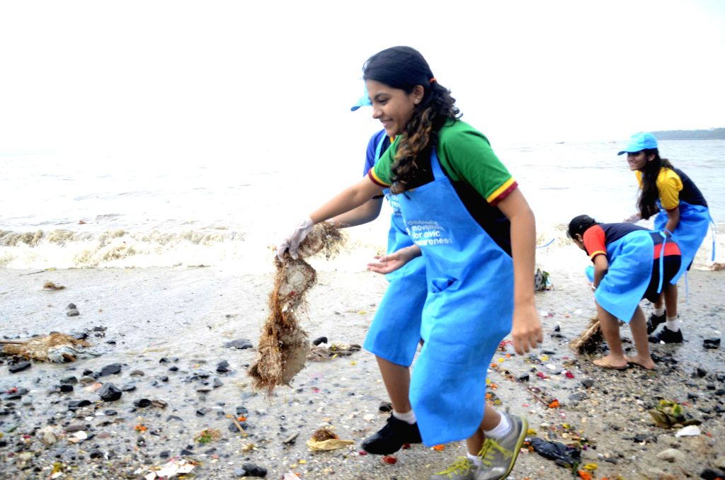 School students engaged in cleaning of the Girgaon Chaupati, a day after Ganapati immersions in Mumbai on Sept 9, 2014.