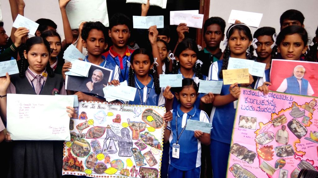 School students from various schools write letters to Prime Minister Narendra Modi urging him to intervene in Cauvery issue in Bengaluru on Sept 24, 2016. - Narendra Modi