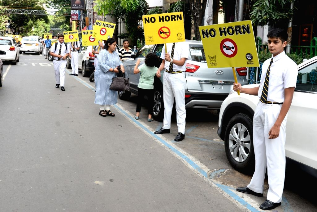 "School students hold ""No Horn"" placards as they participate in an awareness rally urging people not to use horns unnecessarily while driving as honking not only causes noise ..."