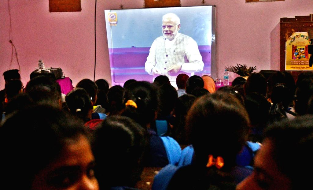 School students listen to Prime Minister Narendra Modi as he speaks during the 'Pariksha Pe Charcha' in Patna on Feb 16, 2018. - Narendra Modi