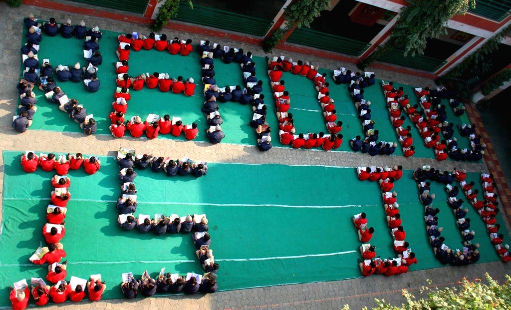 School students observe `World Reading Day` in Amritsar on Nov 27, 2015.