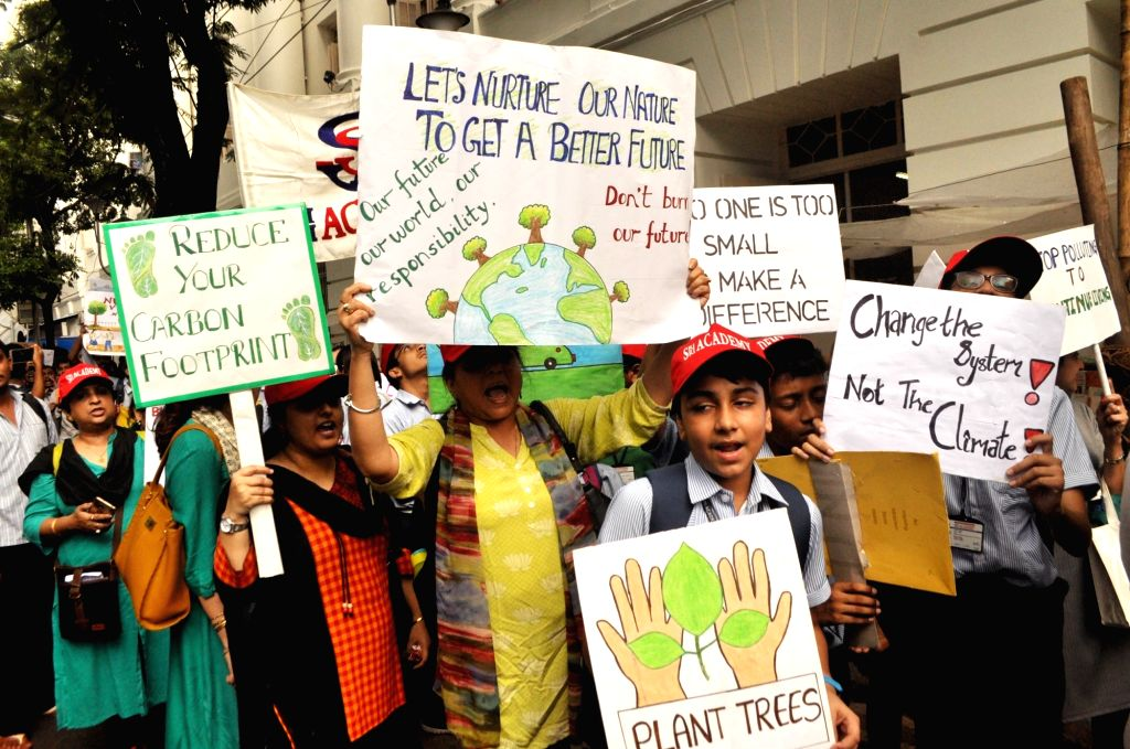 """School students participate during the """"March for Climate Justice"""" in Kolkata on Sep 27, 2019."""