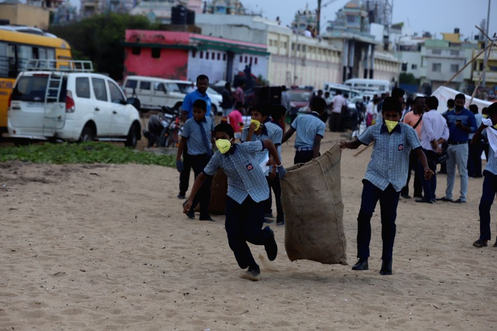 School students participate in a beach clean-up drive organised jointly by U.S. Consulate General in Chennai and the Indian Maritime Foundation on the occasion of World Cleanup Day, near ...