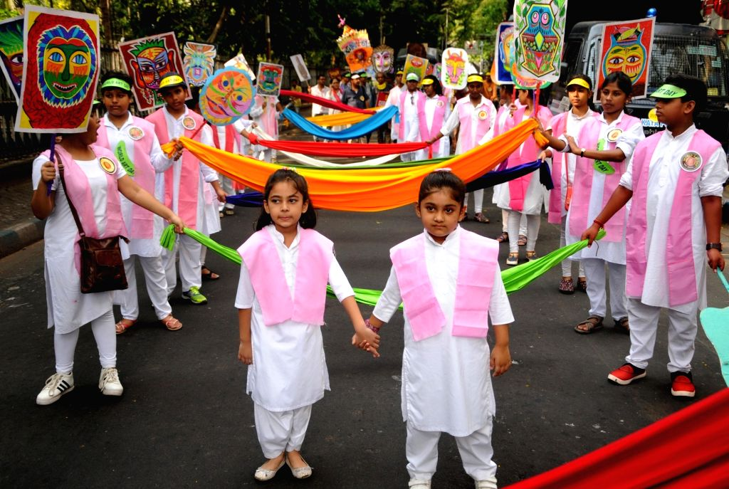 School students participate in a rally organised to celebrate World Art Day, in Kolkata on April 15, 2019.