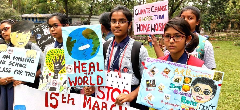 School students participate in a rally to raise climate change awareness in Kolkata, on March 15, 2019.