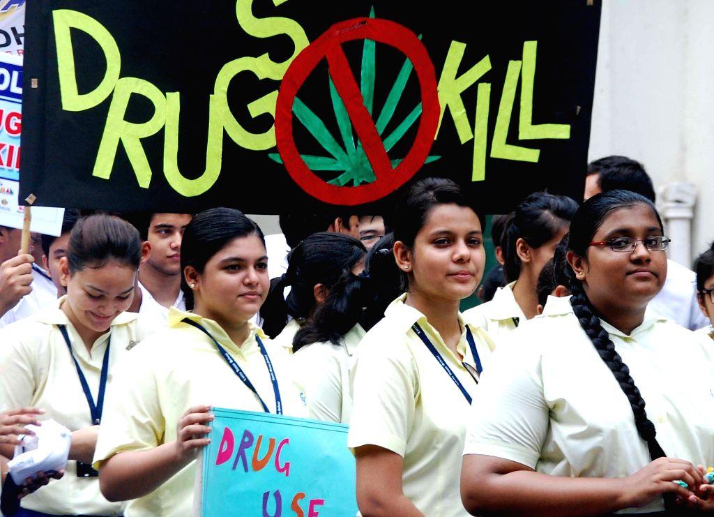 School students participate in 'A Walk for Anti Drug Movement' in Kolkata on June 24, 2014.