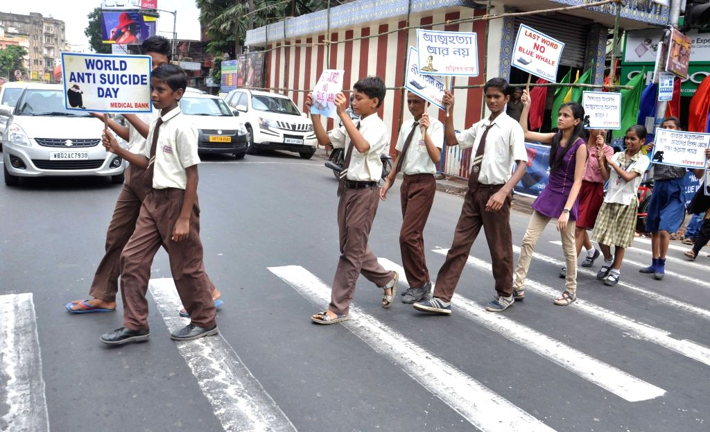"School students participate in an awareness rally on suicide video game - ""Blue Whale"" on World Suicide Prevention Day in Kolkata on Sep 10, 2017."