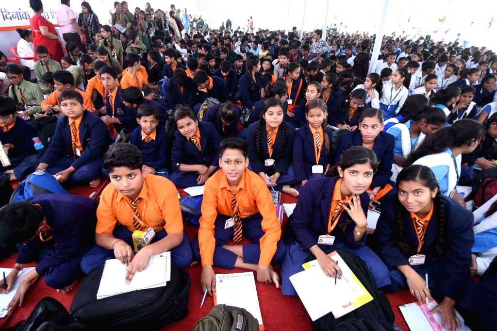 School students participate in an essay competition during a programme organised on the 135th birth anniversary of India's first President Rajendra Prasad, in Patna on Dec 3, 2019.