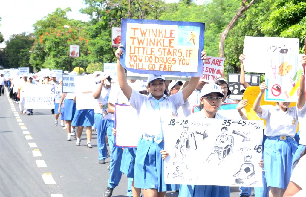 School students participate in part in a awareness rally on International Day against Drug Abuse and Illicit Trafficking in Kolkata, on June 26, 2016.