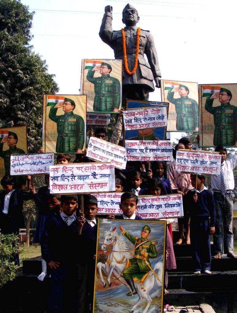School students pay tribute to Netaji Subhash Chandra Bose on his birth anniversary celebration in Varanasi, on Jan 23, 2016.