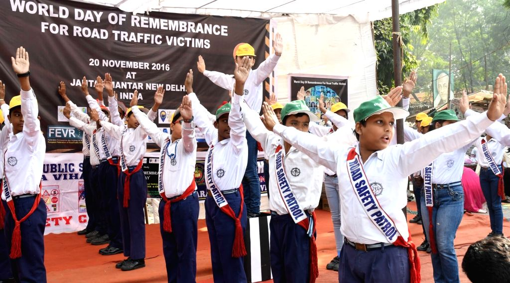 School students perform a drill to observe World Day of Remembrance for Road Traffic Victims at Jantar Mantar in New Delhi on Nov 20, 2016.