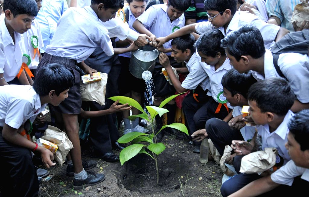 School students plant saplings as part of environment drive in Kolkata on August 17, 2013. (Photo::: IANS)