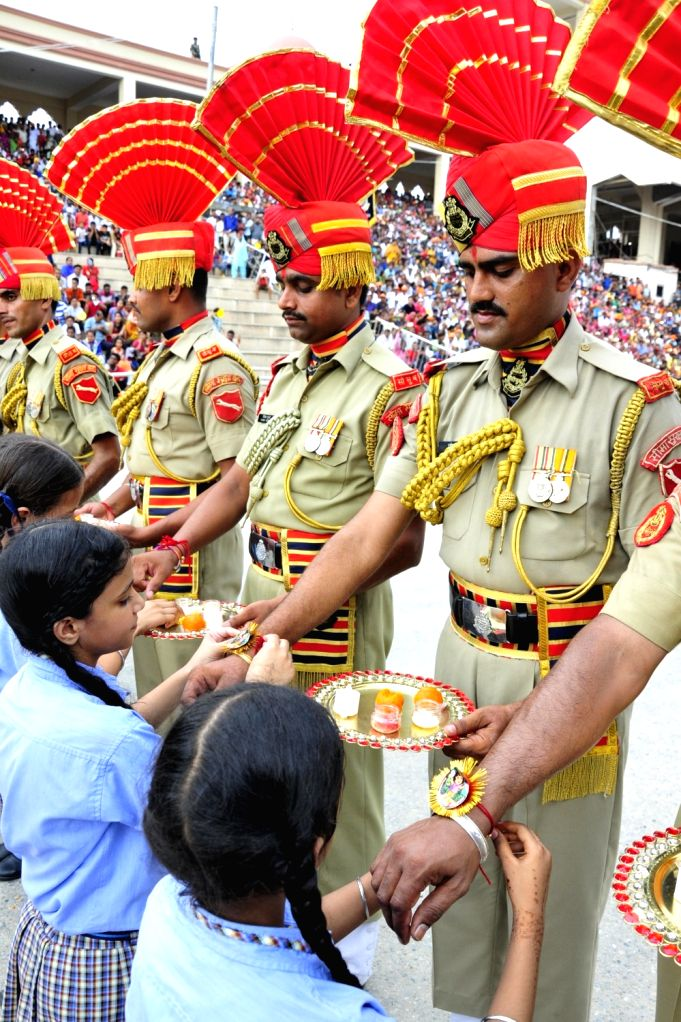 School students tie rakhis on the wrist of BSF soldiers during pre-Rakhi celebrations at Attari-Wagha border on Aug 2, 2017.