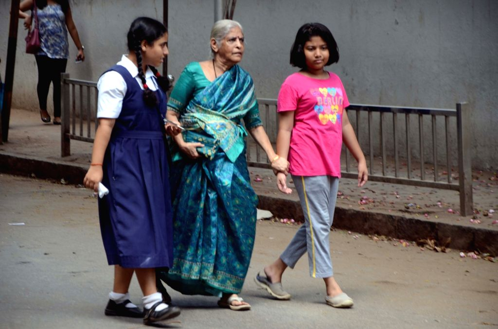 School students volunteer to escort old voters to the polling stations during the fourth phase of 2019 Lok Sabha elections at Dadar in Mumbai, on April 29, 2019.