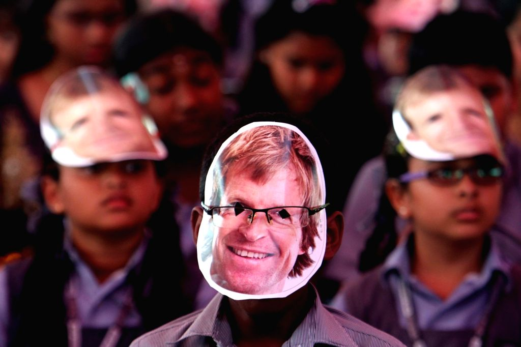 School students wearing former South African cricketer Jonty Rhodes' masks greet him during his visit to their school in Chennai on Aug 9, 2017.