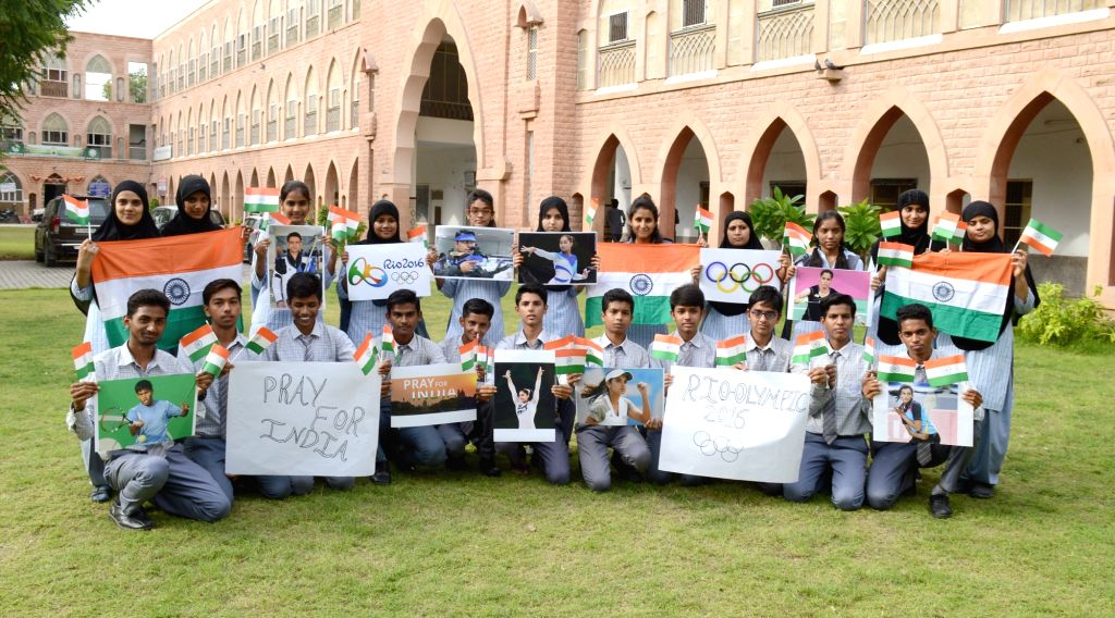 School students wish luck to Indian contingent at the Rio Olympics 2016 in Jodhpur, Rajasthan on Aug 13, 2016.