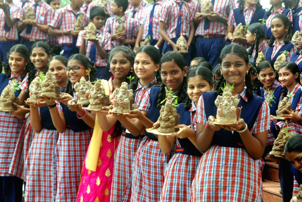 School students with Eco-Ganesha idols during the launch of Eco-Ganesha distribution and awareness programme initiative in Hyderabad on Aug 17, 2017.