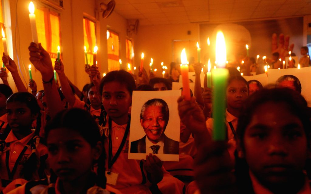 Schoolchildren during a candle light vigil in Chennai to condole the death of anti-apartheid icon Nelson Mandela who died on 5th Dec at the age of 95 in Johannesburg, on Dec.6, 2013.