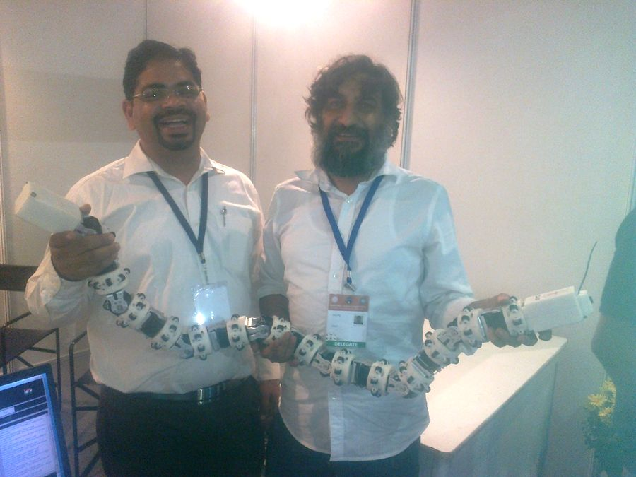 Scientists with the snake robot developed by them.