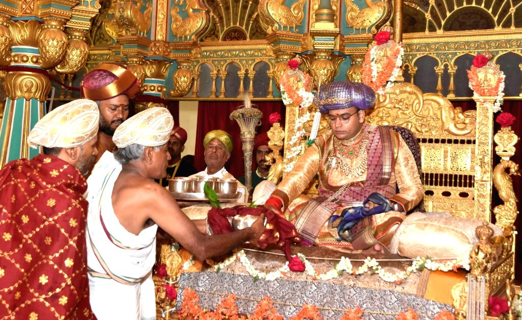 """Scion of the erstwhile royal family of Mysore, Yaduveer Krishnadatta Chamaraja Wadiyar performs pooja to """"Golden Throne"""" at the Private darbar hall during the inauguration of Dasara ..."""