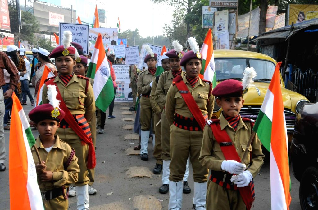 Scouts, students and people participate in a silent protest rally against militant attack on a CRPF convoy in Jammu and Kashmir's Pulwama district in which 49 soldiers lost their lives; in ...