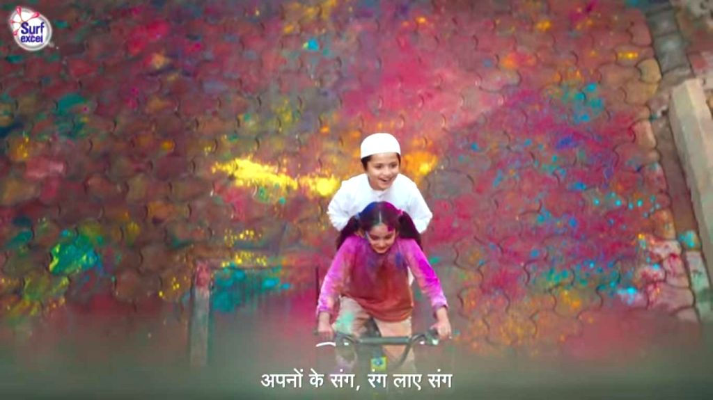 "Screen Grab of the latest commercial, part of Surf Excel's ""Daag Achche Hai Campaign"", that shows a Hindu girl saving a Muslim boy from colours on Holi."