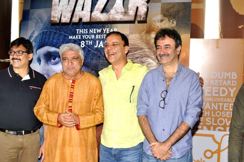 Screen play writer Abhijat Joshi, lyricist Javed Akhtar, filmmakers Rajkumar Hirani and Vidhu Vinod Chopra during the trailer launch of film Wazir in Mumbai on Nov 18, 2015. - Abhijat Joshi and Vidhu Vinod Chopra