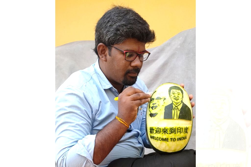 Sculpture seems to be the flavour of the season now. 31-year old M. Elanchezhian, fruit &vegetable carving artists from Gudalur in Theni district, Tamil Nadu, has carved out the images of Prime Minister Narendra Modi and Chinese President Xi Jinping  - Narendra Modi