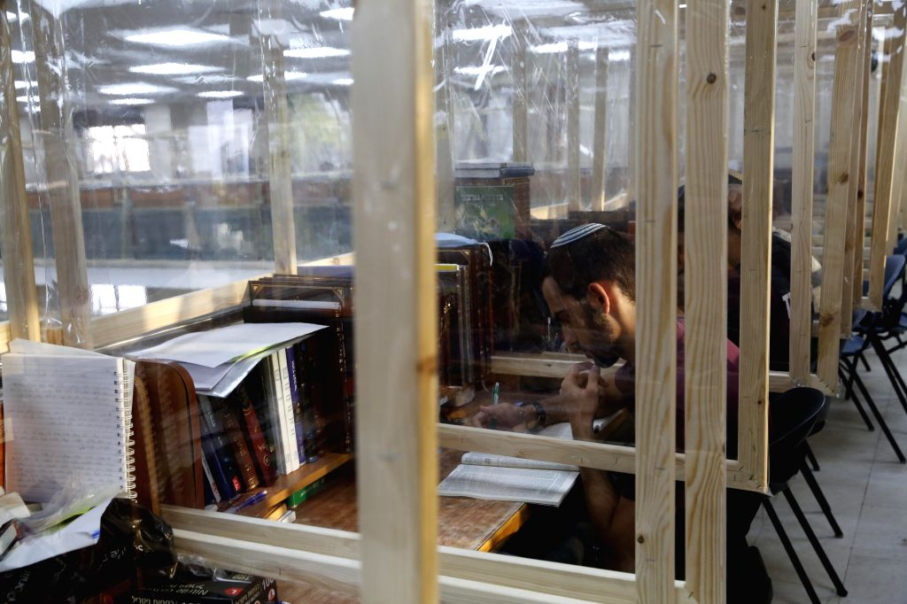 Sderot (Israel), Aug. 30, 2020 People study at a Yeshiva, a Jewish seminary, amid COVID-19 pandemic in southern Israeli city of Sderot, on Aug. 30, 2020. Israeli Ministry of Health ...