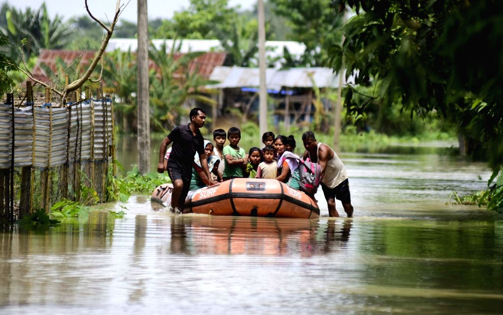 SDRF personnel carry out rescue operations in Assam's flood affected Barpeta, on July 25, 2019.