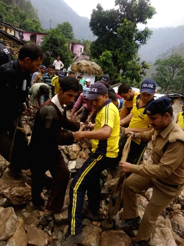 SDRF personnel conduct rescue operations after cloud burst in Almora district of Uttarakhand on June 3, 2019.