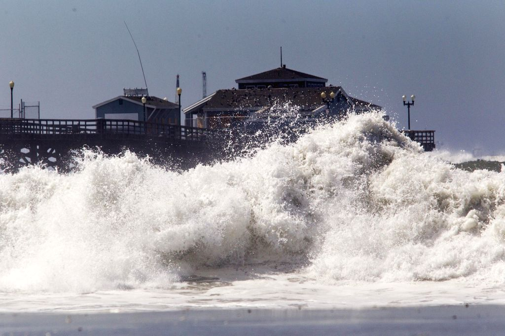 SEAL BEACH (U.S.), Aug. 28, 2014 A big wave smashes against the pier as Hurricane Marie brings huge waves at Seal Beach in California, the United States, Aug. 27, 2014. The homes at ...