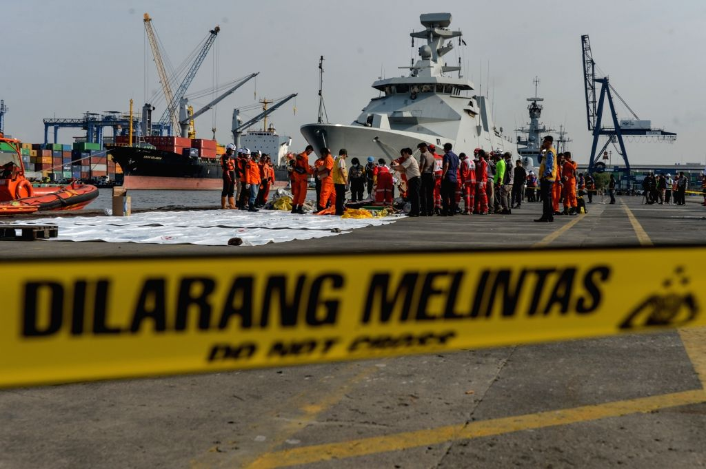 : Search and Rescue officers collect the debris and passengers'personal items of the Lion Air JT610 that crashed into the sea off Karawang of West Java ...