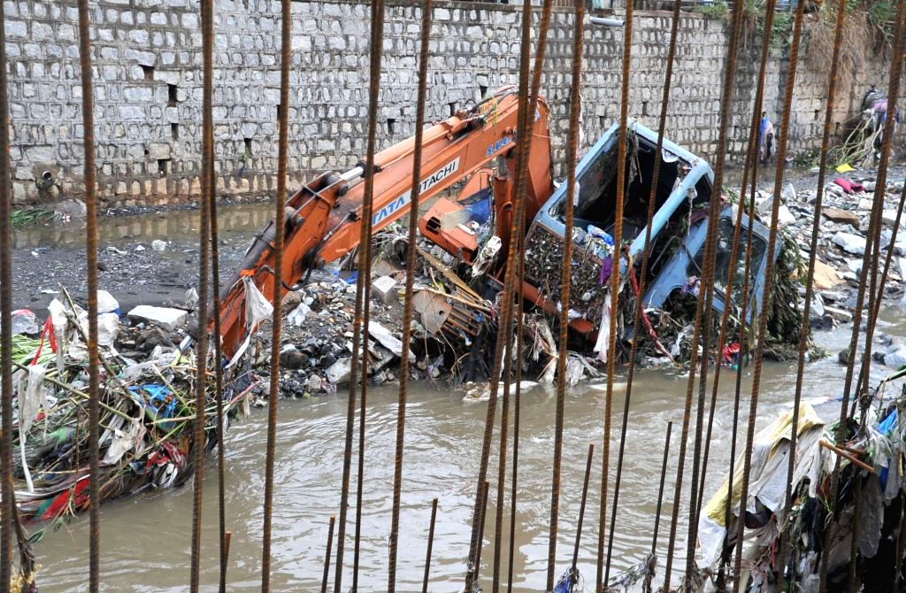 Search operations for Shanthakumar, a civic supervisor who fell into a storm water drain amid heavy rain underway in Bengaluru on May 21, 2017. Shanthakumar, 35, was supervising the ...