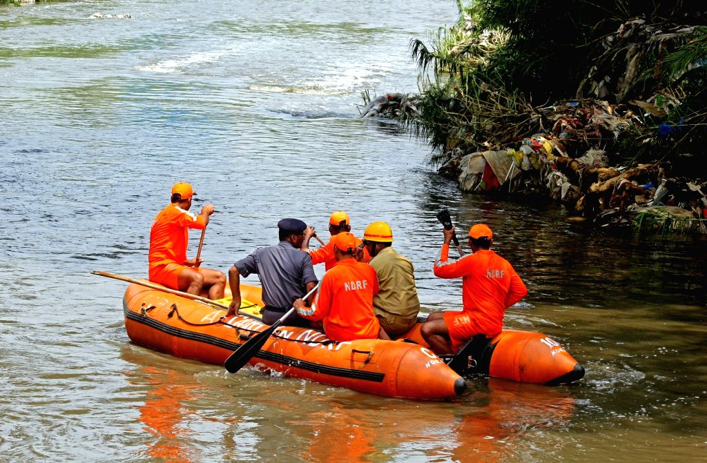 Search operations for Shanthakumar, a civic supervisor who fell into a storm water drain amid heavy rain underway in Bengaluru on May 22, 2017. Shanthakumar, 35, was supervising the ...