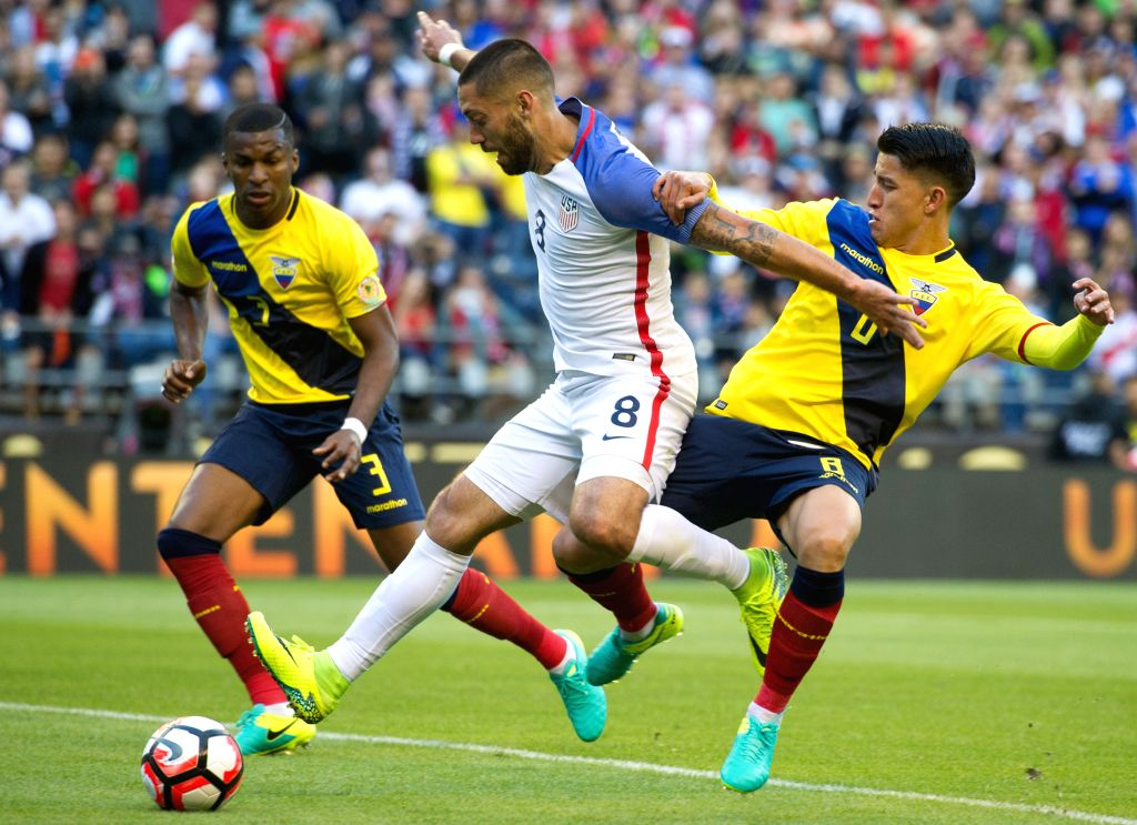 SEATTLE, June 17, 2016 - Clint Dempsey (C) of the United States vies with Fernando Gaibor of Ecuador during a quarterfinal of the 2016 Copa America soccer tournament at the Century Link Field in ...