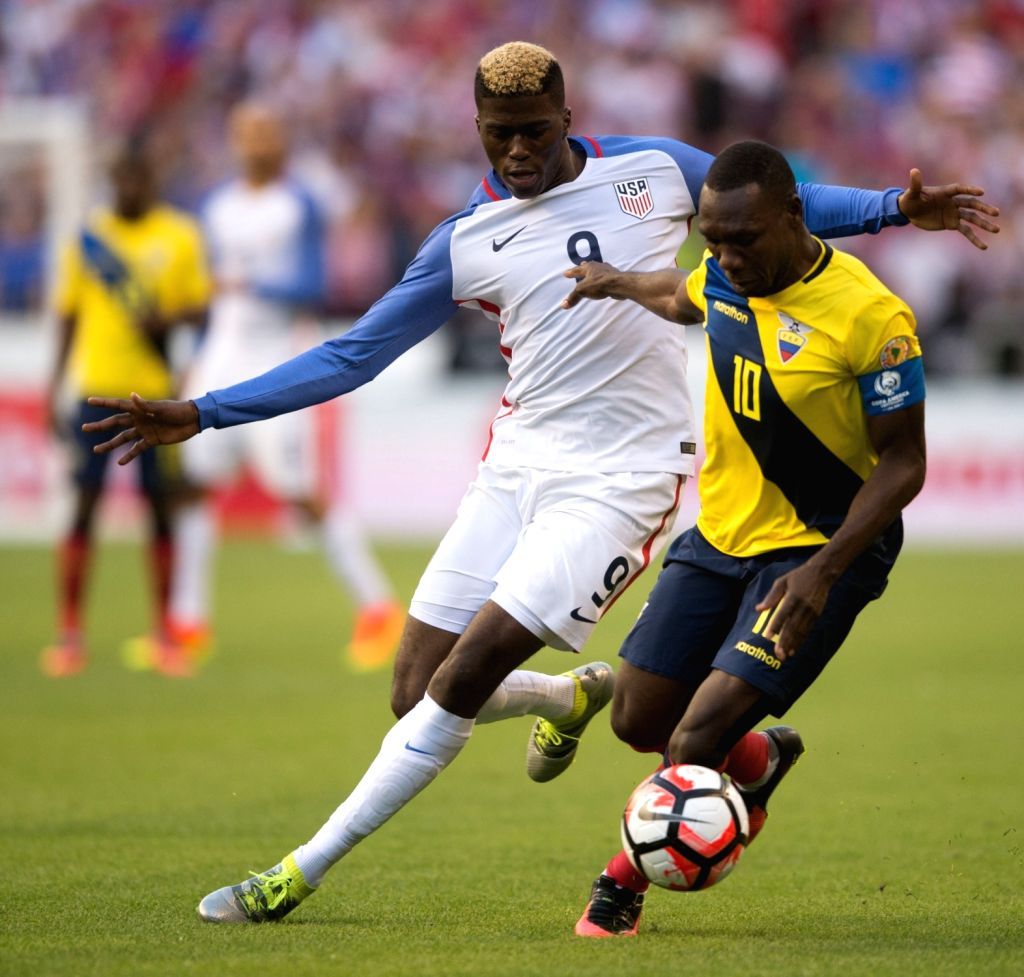 SEATTLE, June 17, 2016 - Gyasi Zardes (L) of the United States vies with Walter Ayovi of Ecuador during their quarterfinal match of 2016 Copa America soccer tournament at Century Link Field in ...