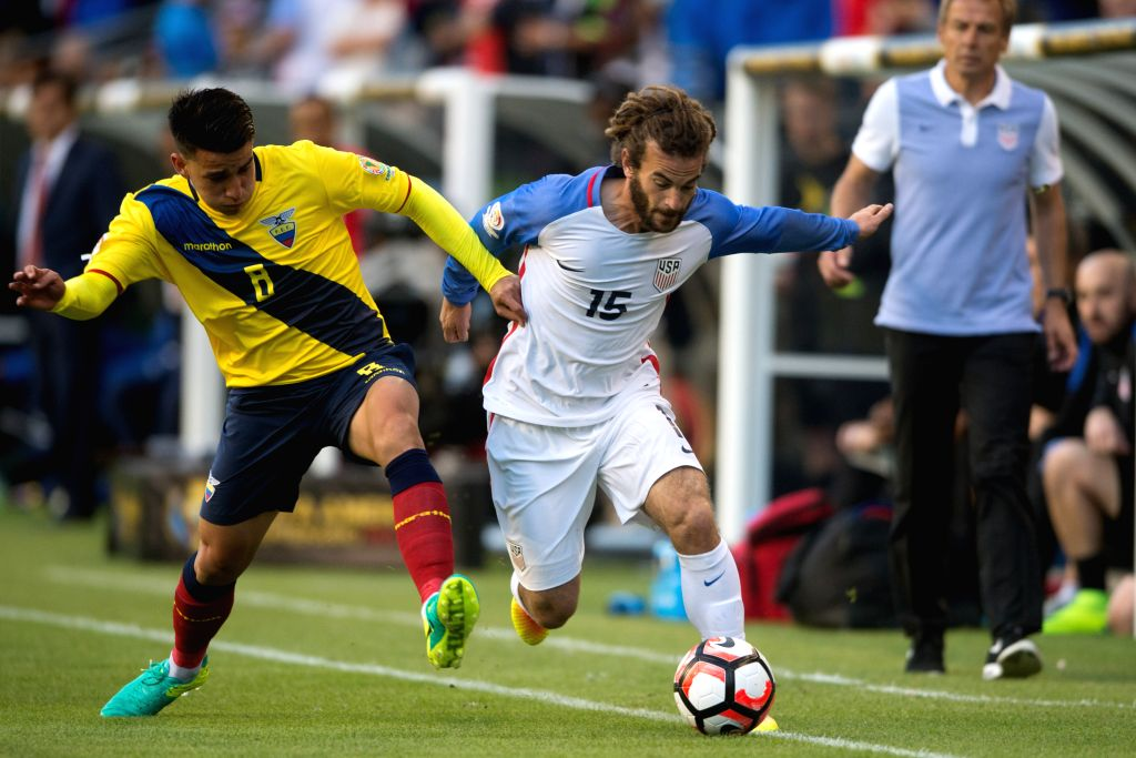 SEATTLE, June 17, 2016 - Kyle Beckerman (R) of the United States vies with Fernando Gaibor of Ecuador during their quarterfinal match of 2016 Copa America soccer tournament at Century Link Field in ...